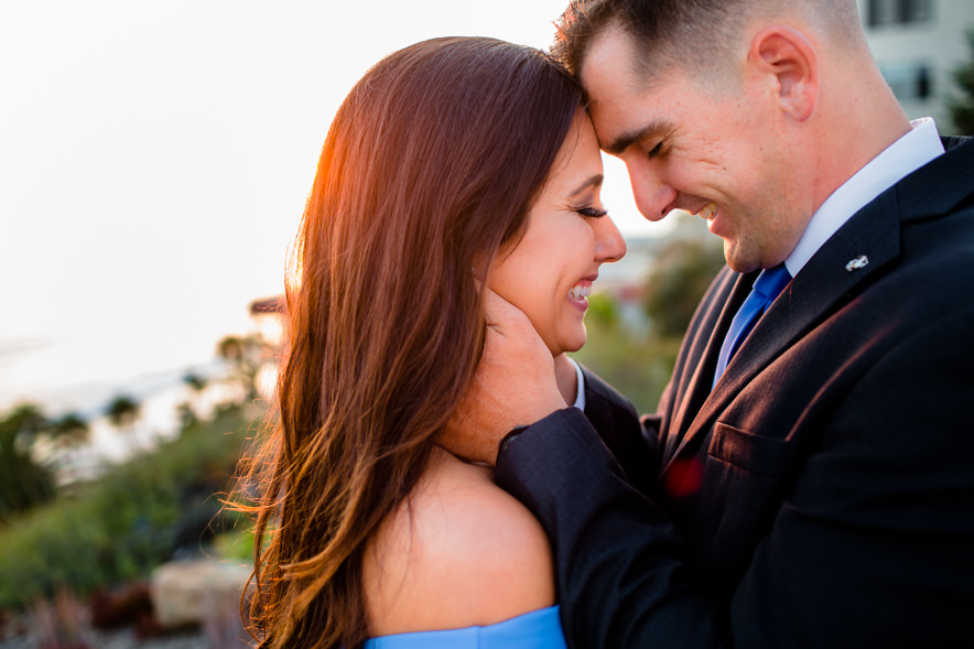 foreheads touch as groom holds his fiancé close