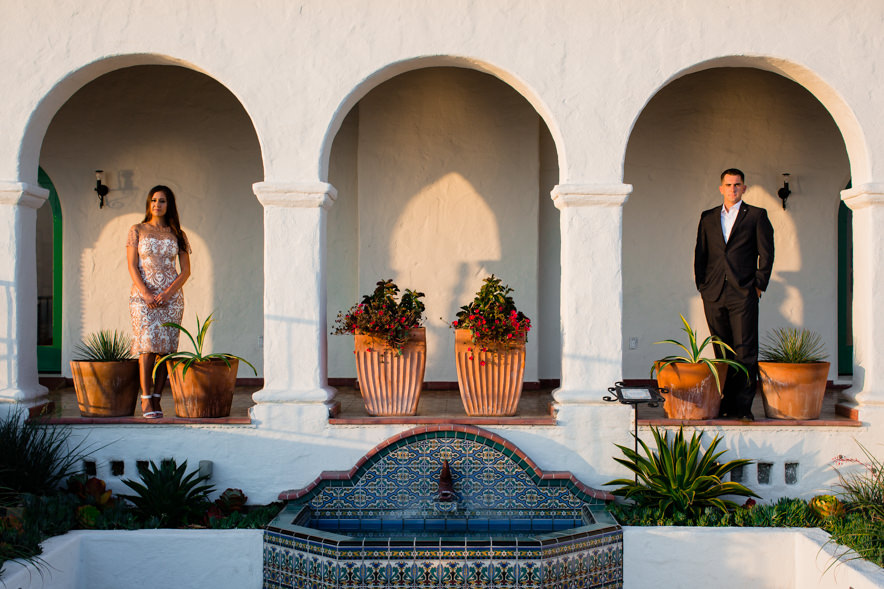 an artistic picture of the couple in an archway of Casa Romantica