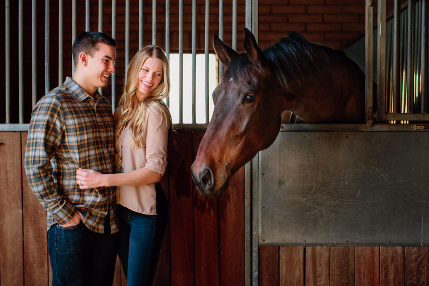 engagement photo in a horse's stable