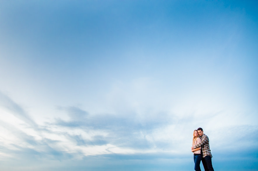 barn engagement session with a big blue sky